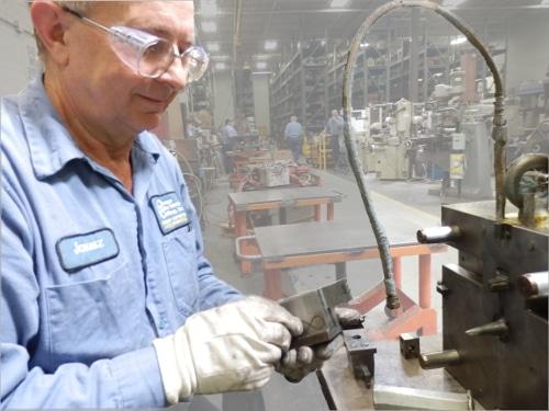 Janusz Niemczura working on a repairing a die casting die tool.