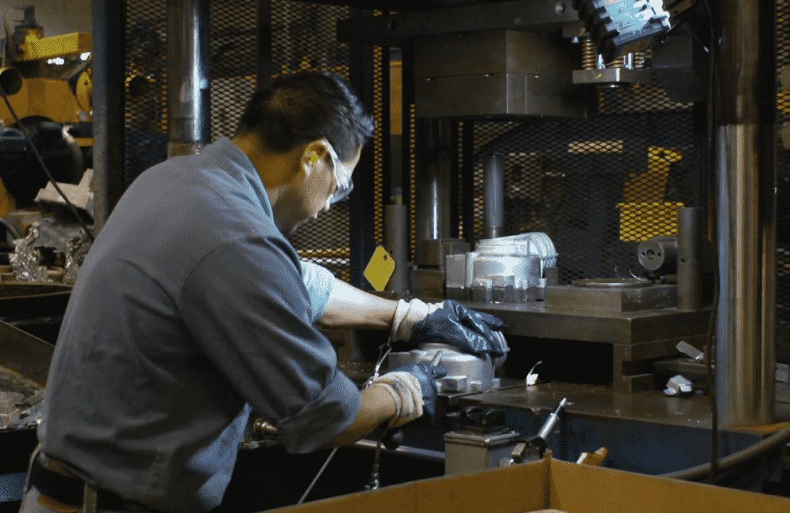 CWM Employee working on Aluminum Die Cast Filling